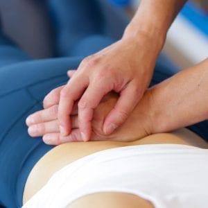 Woman having physio on back