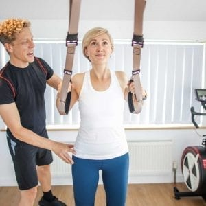 Mike helping Becky with a personal training session