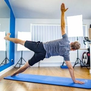 Mike doing a side plank during one of the online Pilates classes