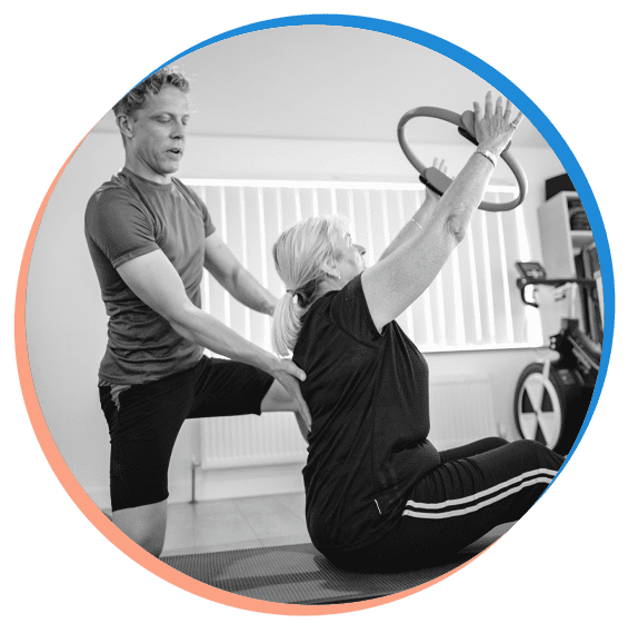 Mike with a client on a Rehab Pilates class