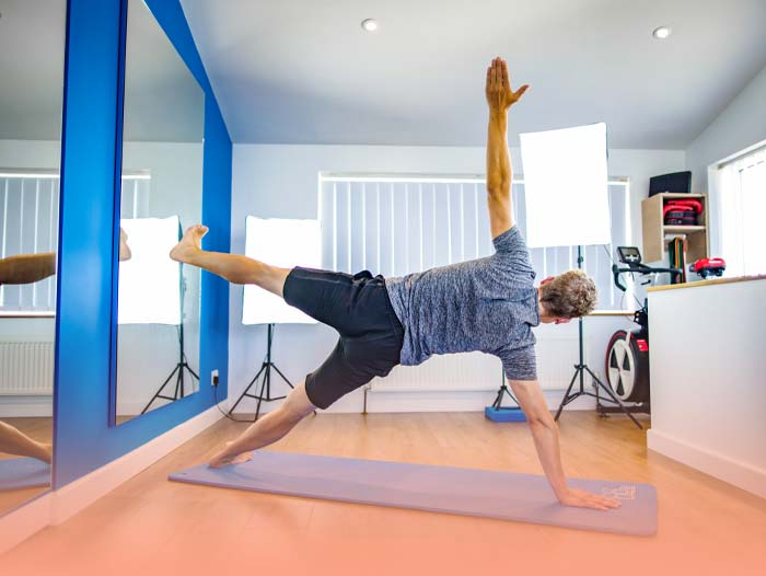 Mike holding a side plank during one of the Pilates classes